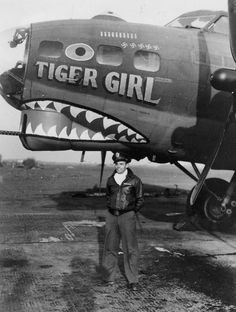 "Vintage Aircrafts - A crew member in front of ""Tiger Girl"" of the Bomb Group Nose Art, Ww2 Aircraft, Military Aircraft, Military Art, Military History, Tiger Girl, Aircraft Painting, Rockabilly, Airplane Art"
