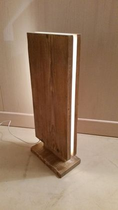 Reclaimed Wood Led Floor Lamp - Floor Lamps, Wood Lamps - Cute wooden LED floor lamp, the wood was salvaged from old axles for construction sites that have been lightly sanded and finished with transparent water-based … Read Diy Floor Lamp, Wooden Floor Lamps, Table Lamp Wood, Wooden Lamp, Table Lamps, Edison Lampe, Led Lampe, Diy Luminaire, Old Wood Floors