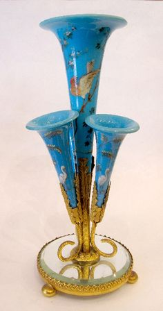 An unusual blue opaline glass epegne with 4 flutes, each handpainted with birds.