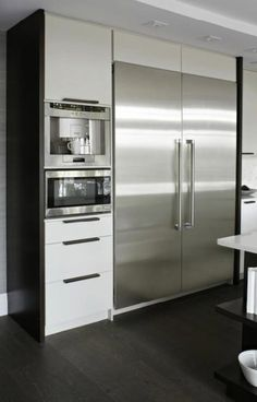 kitchens - modern glossy white lacquer floor to ceiling kitchen cabinets espresso stained wood floors  Virginia Macdonald Photography - Fantastic