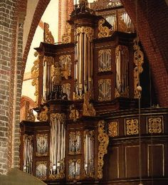 GERMANY: Norden.  Ludgerikirche.  Organ built by Arp Schnitger, 1686.   III/P, 46 stops. Various alterations were done over time and eventually undone to restore the instrument.  1957-1959 restoration by Paul Ott with mechanical action. 1981-1985 restoration by Jürgen Ahrend to its original (Schnitger) tonal design.