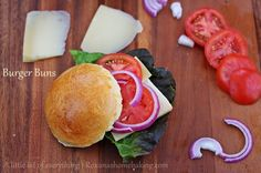 Homemade Burger Buns   this one shows you how to knead by hand,   and this uses MASHED POTATOES