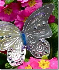 aluminum butterflies, made from recycled tin foil plates? They would be perfect for this gardening project.