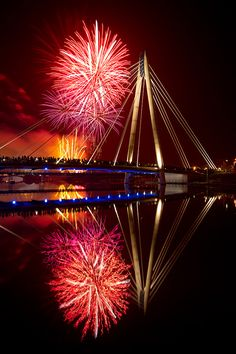 Mirrored Sync by Paul Sutton, via 500px Awesome fireworks over a special bridge let it be one to unite us and not to separate us.