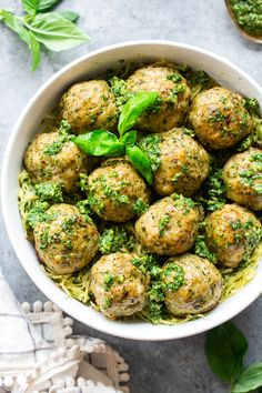 These pesto chicken meatballs are loaded with flavor, easy to make and packed with protein and healthy fats. A great weeknight meal served over spaghetti squash or zucchini noodles, they're Paleo, compliant and keto friendly too! Paleo Pesto, Healthy Pesto, Healthy Fats, Whole30, Paleo Running Momma, Chicken Meatballs, Keto Meatballs, Protein, Ground Chicken Recipes