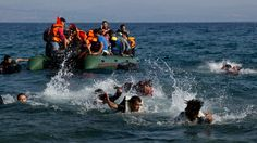 Migrants and refugees whose boat stalled at sea while crossing from Turkey to Greece swim toward the shore of the Greek island of Lesbos on Sunday. Thirteen died and 27 are missing after boat crashes and a sinking.
