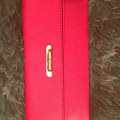 Michael kors hot pink wallet Hot pink Michael kors wallet. Brand new, and never been used. Michael Kors Bags Wallets