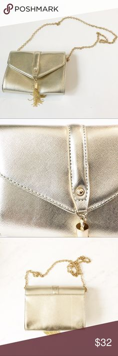 5f0a572f3b62 Guess gold evening bag with chain strap Guess metallic gold evening bag  with chain shoulder strap