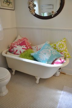 I want a bathtub full of pillows...and i like the mirror too!