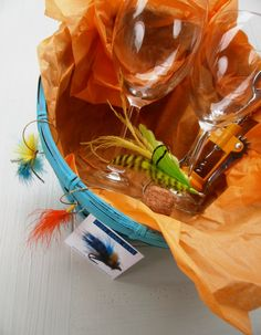 Awesome gift basket for the wine and fishing lover! 2 wine glasses, fly wine charms, wine bottle opener and wine stopper!