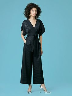 This kimono-style, 100% silk, short sleeve jumpsuit features a detachable fabric belt and contrasting-colored panels that add depth to this roomy and sleek wardrobe staple.v