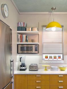 Saving Space: 15 Ways Of Mounting Microwave In Upper Cabinets, with open shelving #cottageshelves