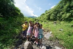 Local children in the shadow of Mount Mayon The Philippines