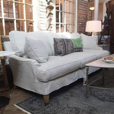 Just in - a slipcovered english-arm sofa. Looks good against our house, huh? Living Room Redo, Living Room Remodel, Custom Slipcovers, Furniture Slipcovers, Striped Sofa, Upholstered Furniture, Den Furniture, Fabric Sofa, Soft Furnishings