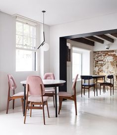Understated elegance in this space at @mulberryandprince_ct with a slate bar copper tables white-washed walls and accents of dusty pink. Via @yellowtrace