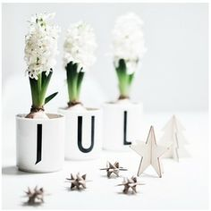 White Christmas decoration in porcelain cups. Spell 'Christmas' or 'Jul' in Danish with the cups.