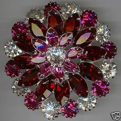 I collect vintage jewelry...this is a beauty! Signed Eisenberg Swarov. Rhinestone Kaleidoscopic Flower Brooch