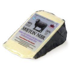 OVEJAS NEGRO MOUTON NOIR Noyan (Quebec) Refinado en los medios de 2 a 3 meses, este queso semi-curado presionado, sin cocer, se elabora con leche de vaca pasteurizada. Bajo su superficie cubierta con film negro de alimentos presenta una pasta blanca, suave y cremoso, ligeramente agrio sabor de la leche fresca.