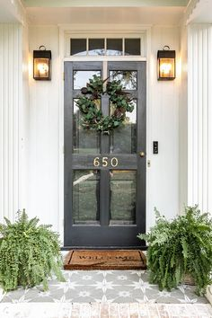 Front porch decorated for early fall with DIY wreath and stenciled floor. A quick and simple tutorial to make a neutral Fall wreath using artificial stems and branches already in your stash.
