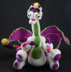 Every kid needs a dragon in their life! Or a panda, or a bear, or any of Pencil and Sheep's felted creatures. They are purveyors of happiness!