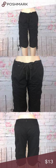 "Calvin Klein cargo capris size 12 Cute pair of black cargo capris by Calvin Klein Size 12 waist measures 17"" 🌺😊🐾🐾 Calvin Klein Pants Capris"