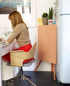 Éléonore's tiny home doubles as an occasional office. A PS corner cabinet stores her camera collection.