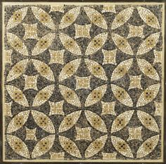 A Roman geometric mosaic panel Circa 3rd-4th Century A.D. Composed of black, white and yellow tesserae, with an overall pattern of intersecting disks, smaller squares in the spandrels, 36in x 36in (91.5cm x 91.5cm)