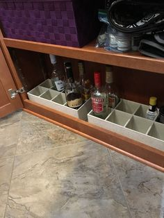 Liquor bottle storage in a fifth wheel bottom shelf. great for travel!                                                                                                                                                                                 More