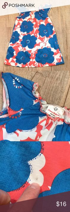 "Hanna Andersson 110 Tunic Hanna Andersson size 110 (5-6) in VGUC. Pretty blue, white and coral floral print! Measures 23"" long-may be a dress or tunic.  One small spot-see photo. (5-85) Hanna Andersson Shirts & Tops Blouses"