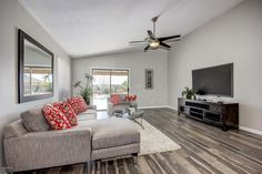 """Contemporary Living Room with Ceiling fan, Hardwood floors, 54"""" Stealth DC 5 Blade Ceiling Fan with Remote, Carpet"""