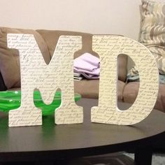 DIY #2 -- decoupage initials for decor around the cake table! Easy! Get some letters at Michaels (use the coupons!), mod podge (pricy but affordable with a coupon!) and paper you want to cover the letters in. Can easily be done for under $10 -- did this for roughly $4.50 for each letter.