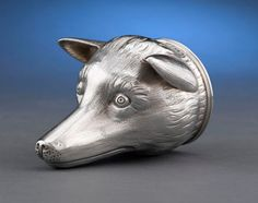 1912 An English silver stirrup cup in the form of an upturned fox head, features an engraved crest on the underside of the jaw. Traditionally, stirrup cups were used for farewell drinks, often offered to a rider already mounted for departure