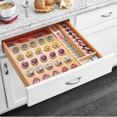 Features:  -Includes: 1 Solid wood drawer insert.  -Will hold up to 30 pods before the unit is cut.  -Attractive wood construction with durable clear finish.  -Can be trimmed to exact size with table