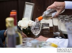 Gatherings bartender pouring wine for the wedding guests, http://eventsbyclassic.com