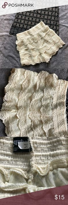 Lace shorts adorable Lace shorts layered over silky material. Elastic waist. Will make a good match for a semi dress casual summer outfit. Tag says medium but they fit as a small. Slight fraying on bottom, not unraveling. fancy cube Shorts Skorts