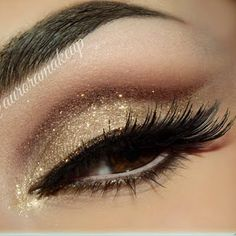 Go bold and brown with this breath taking eye shadow and glitter combo. Bag this perfect inspiration for your next night out.