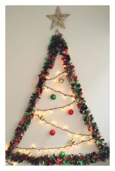 Lighting up Christmas trees is an age-old tradition. Outdoor Christmas lights decorations will help you to make your home beautiful. Wall Christmas Tree, Office Christmas, Diy Christmas Gifts, Xmas Tree, Simple Christmas, Christmas Ornaments, Christmas Wreaths, Easy Christmas Decorations, Decorating With Christmas Lights