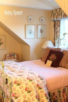 Betsy Speert's Blog: Floral Cottage Bedroom - love the brown embroidered pillow