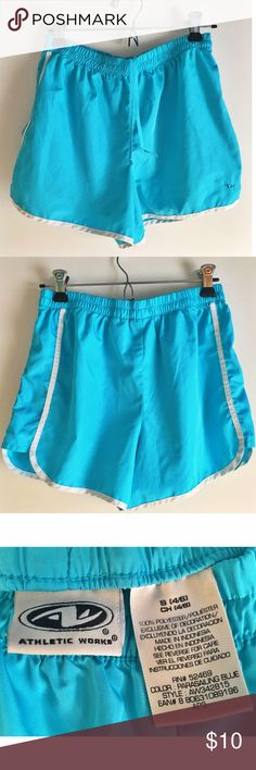 Running shorts Never worn light blue running shorts. New without tags. Elastic waist band, light-weight and great for working out! Athletic Works Shorts