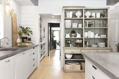 A view into the working pantry, which connects to a bar area that services the Whites' dining room.
