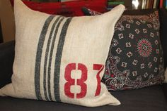 stenciled grain sack pillows, crafts, Finished Grain Sack pillow on the black denim sofa with the bandana pillows from last month Stenciled Pillows, Diy Pillows, Cool Diy, Steel Wool And Vinegar, Denim Sofa, Diana, Plain Cushions, Funky Junk Interiors, Pillow Tutorial