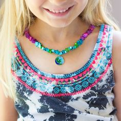 Make your own planets and stars necklaces - a fun kids summer camp craft for Outer Space week!