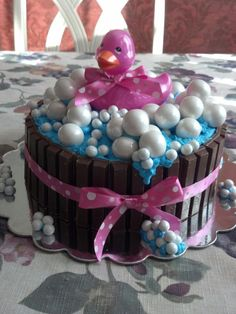 Duck in a Tub Cake ~ French Vanilla Sponge Cake filled with Vanilla Custard, Iced with Buttercream, covered with a Kit Kat Tub, Finished with Sparkly Gumballs & Chocolate Candy & topped with a Pink Duck that lights up & Glows!