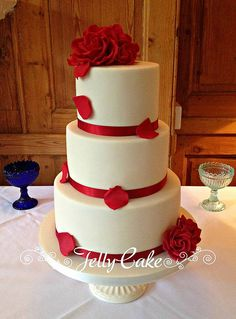 Red Roses Wedding Cake | Flickr - Photo Sharing! Red sugar roses with petals tumbling all set up at The Rectory.