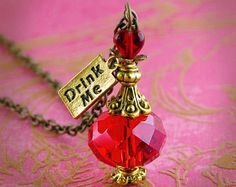 "Harry Potter ""Amortentia"" love potion necklace. I love the idea of using beads to make a potion bottle."