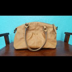 ~ Tan Purse with Many Pockets ~ Rainbow stripe interior. One interior pocket for feminine products; spacious and roomy for all of your necessities! Four exterior pockets. A perfect everyday catch all purse! Merona Bags Hobos