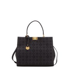 Women's handbag from the KANIKA CRUZ line by Carpisa, made in collaboration with Penelope and Monica Cruz, from single-colour material with tumbled leather effect with floral perforated pattern. The practical removable strap, the coloured handles and light-finish insert hanging from the handle render the item elegant and refined. The light-finish swivel fastening completes the bag in its practicality. Available in three colours, a perfect match for every style.