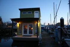 This is Sweet Pea, a 550-square foot tiny houseboat in Olympia, Washington. It's also the first houseboat certified by Built Green — coming in with 3-Stars — and was built by owner Mike Auderer of Olympia Construction.