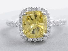 Our lovely ctw Cushion Cut Diamond Engagement Ring. It has a bright and attractive carat Cushion Cut Vivid Yellow Clarity (Clarity Enhanced) Center Diamond. Set in an elegant halo setting and cast in White Gold, it is a gorgeous ring! Canary Diamond, Diamond Girl, Modern Engagement Rings, Halo Diamond Engagement Ring, Modern Jewelry, Fine Jewelry, Jewellery, Jewelry Box, Man Made Diamonds