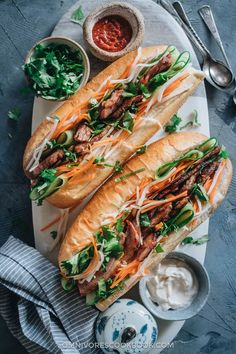 Turn your leftover Easter ham into a Vietnamese favorite with this fast, flavorful ham banh mi sandwich you'll want for lunch every day! A quick pickle recipe is included so you can recreate that authentic taste in your own kitchen. Quick Pickle Recipe, Banh Mi Recipe, Banh Mi Sandwich, Leftover Ham Recipes, Snacks Saludables, Wrap Sandwiches, Asian Recipes, Crockpot, Food Photography